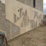 Stenciling a brick wall for a sandblasted design