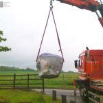 Installation of large boulder