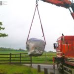 Installation of large boulder