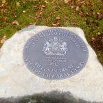 Plaque set into granite boulder